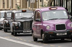 Black Taxi Invasion over Minicab Rank.