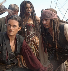 Will Turner (ORLANDO BLOOM), Tia Dalma (NAOMIE HARRIS), and Captain Jack Sparrow (JOHNNY DEPP) in Pirates Of The Caribbean: At World's End. Photographer: Stephen Vaughan. © Disney Enterprises, Inc. All Rights Reserved.