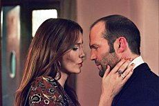 Jason Statham (Terry) and Saffron Burrows (Martine) in The Bank Job. Lionsgate Films
