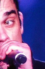 Robbie Williams' Take That tattoo cursed. Photo Credit: hobbs_luton. C.C. License.