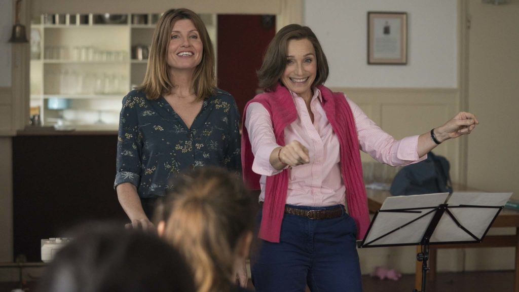 Sharon Horgan as Lisa and Kristin Scott Thomas as Kate in Military Wives, directed by Peter Cattaneo. Photo: Aimee Spinks. Copyright: Lionsgate Films. All Rights Reserved.