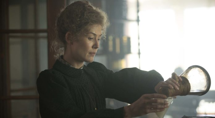 Rosamund Pike as Marie Curie in Radioactive, directed by Marjane Satrapi. Photo: Laurie Sparham. Copyright: StudioCanal. All Rights Reserved.