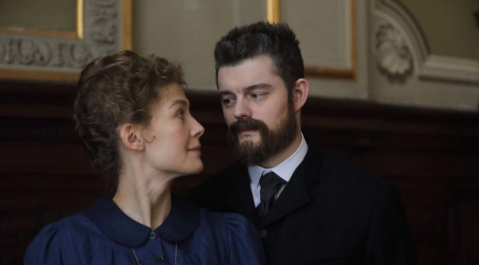 Rosamund Pike as Marie Curie and Sam Riley as Pierre Curie in Radioactive, directed by Marjane Satrapi. Photo: Laurie Sparham. Copyright: StudioCanal. All Rights Reserved.