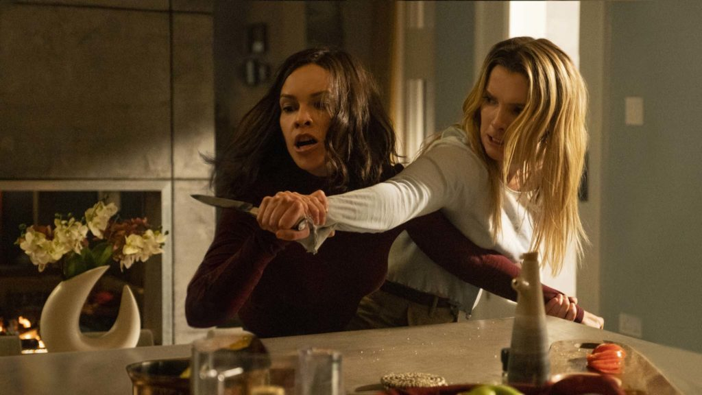 Hilary Swank and Betty Gilpin in The Hunt, directed by Craig Zobel. Photo: Patti Perret. Copyright: Universal Pictures. All Rights Reserved.