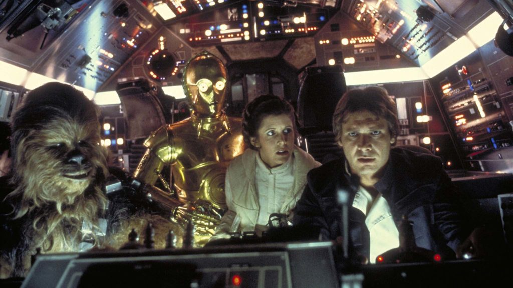 Peter Mayhew as Chewbacca, Anthony Daniels as C-3PO, Carrie Fisher as Princess Leia Organa and Harrison Ford as Han Solo in Star Wars Episode V: The Empire Strikes Back, directed by Irvin Kershner. Photo: Terry Chostner. Copyright: Lucasfilm Ltd. All Rights Reserved.