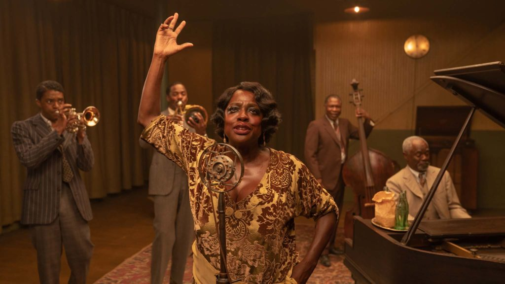 Chadwick Boseman as Levee, Colman Domingo as Cutler, Viola Davis as Ma Rainey, Michael Potts as Slow Drag and Glynn Turman as Toledo in Ma Rainey's Black Bottom, directed by George C Wolfe. Photo: David Lee. Copyright: 2020 Netflix. All Rights Reserved.