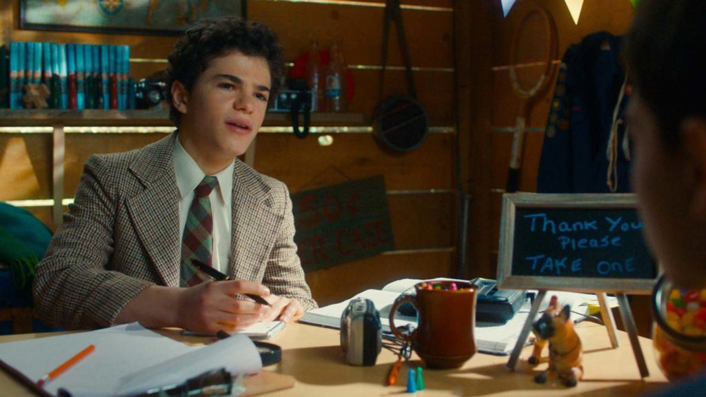 Jesse Noah Gruman as young Abe Applebaum in The Kid Detective, directed by Evan Morgan. Copyright: Sony Pictures Releasing. All Rights Reserved.