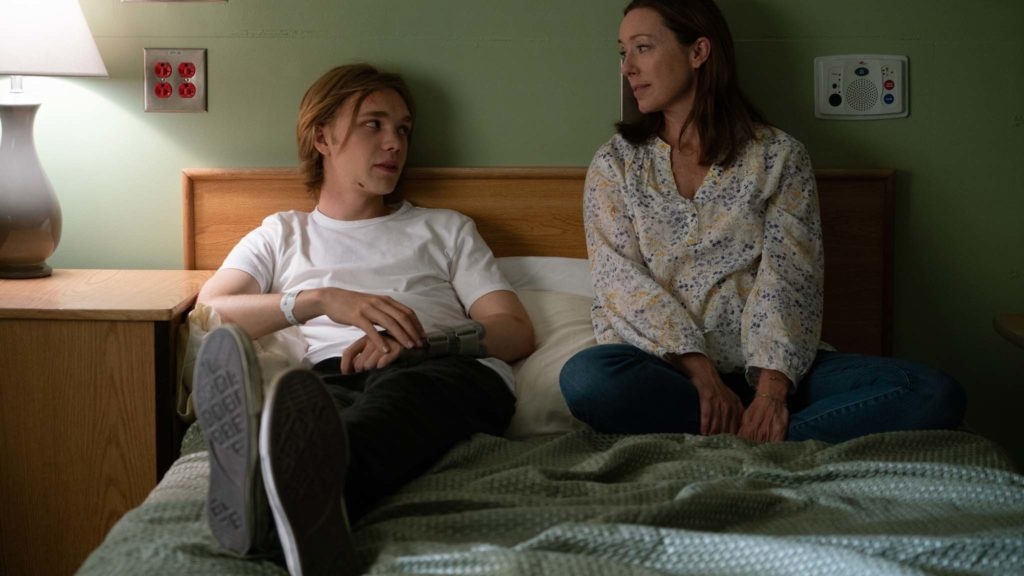 Charlie Plummer as Adam and Molly Parker as Beth in Words On Bathroom Walls, directed by Thor Freudenthal. Photo: Jacob Yakob. Copyright: Sony Pictures Releasing. All Rights Reserved.