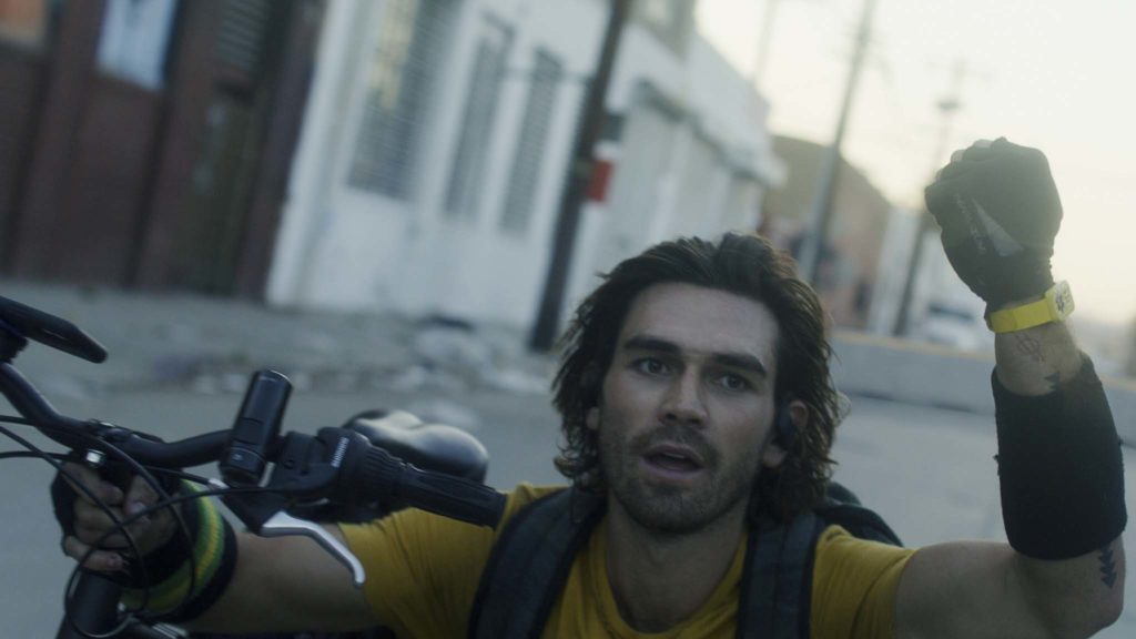 KJ Apa as Nico in Songbird, directed by Adam Mason. Copyright: 2020 STX Financing, LLC. All Rights Reserved.