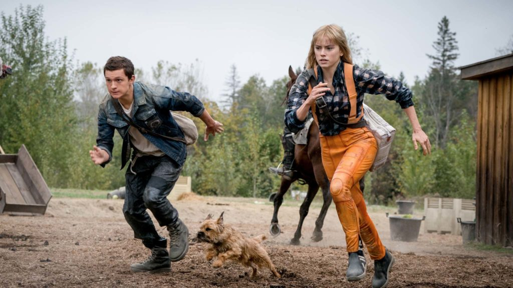 Tom Holland as Todd Hewitt, Manchee the dog and Daisy Ridley as Viola Eade in Chaos Walking, directed by Doug Liman. Photo: Murray Close. Copyright: Lionsgate Films. All Rights Reserved.