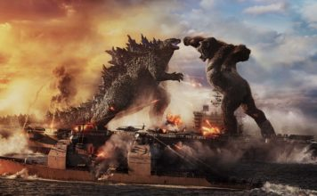 Godzilla battles Kong at sea in Godzilla Vs Kong, directed by Adam Wingard. Copyright: 2021 Legendary And Warner Bros. Entertainment Inc. Godzilla copyright Toho Co., Ltd. All Rights Reserved.