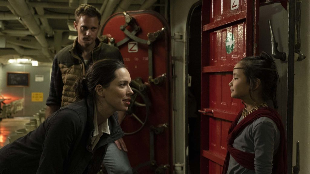 Alexander Skarsgard as Nathan Lind, Rebecca Hall as Ilene Andrews and Kaylee Hottle as Jia in Godzilla Vs Kong, directed by Adam Wingard. Photo: Chuck Zlotnick. Copyright: 2019 Legendary And Warner Bros. Entertainment Inc. Godzilla copyright Toho Co., Ltd. All Rights Reserved.