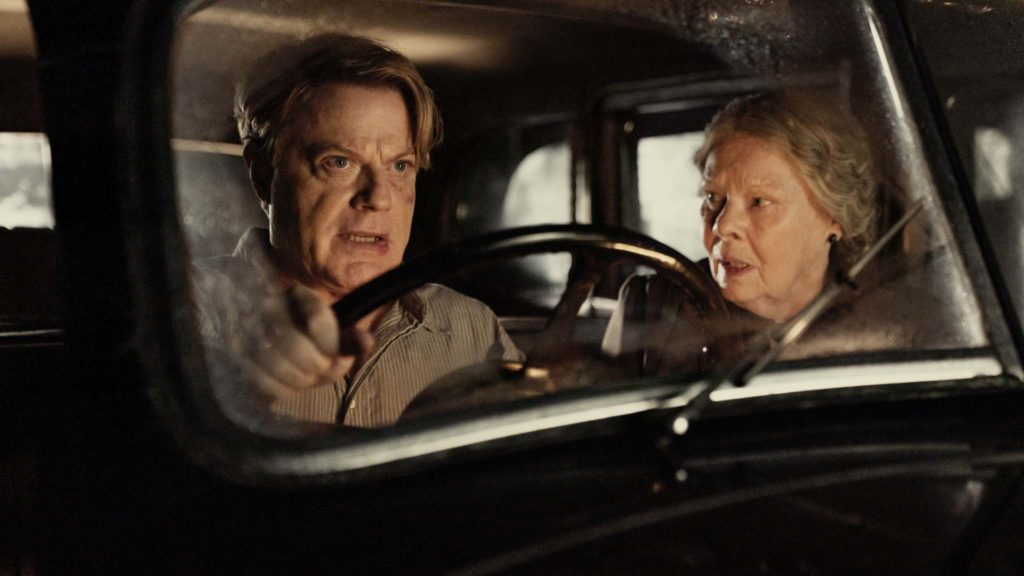 Eddie Izzard as Thomas Miller and Dame Judi Dench as Miss Rocholl in Six Minutes To Midnight, directed by Andy Goddard. Photo: Amanda Searle. Copyright: Reliance Entertainment Productions 6 Ltd. All Rights Reserved.