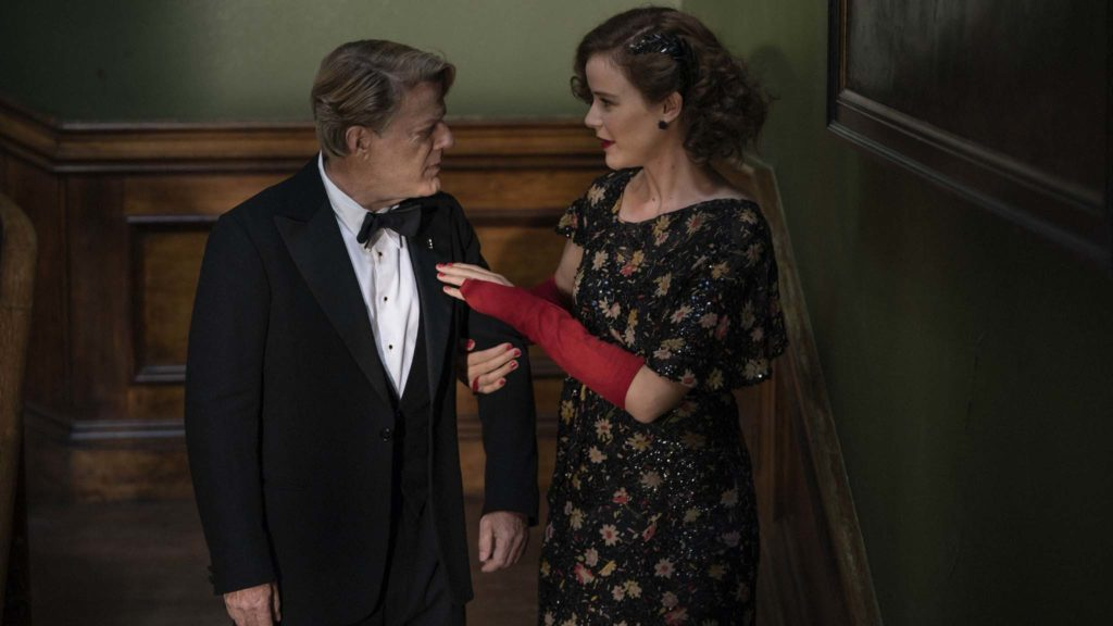 Eddie Izzard as Thomas Miller and Carla Juri as Ilse Keller in Six Minutes To Midnight, directed by Andy Goddard. Photo: Amanda Searle. Copyright: Reliance Entertainment Productions 6 Ltd. All Rights Reserved.