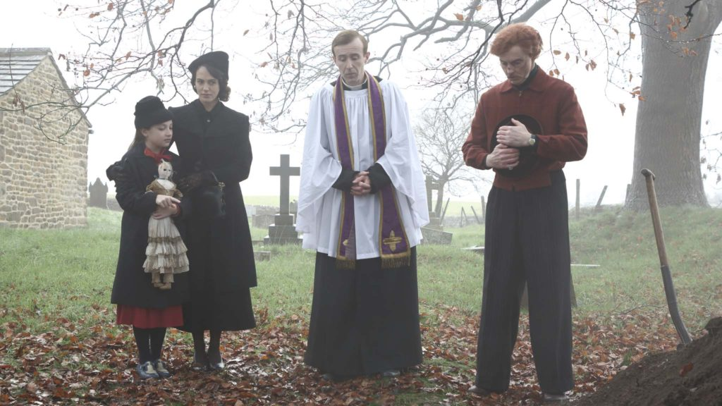 Anya McKenna-Bruce as Adelaide, Jessica Brown Findlay as Marianne, John Heffernan as Linus and Sean Harris as Harry in The Banishing, directed by Christopher Smith. Photo: J Tully. Copyright: Vertigo Releasing. All Rights Reserved.