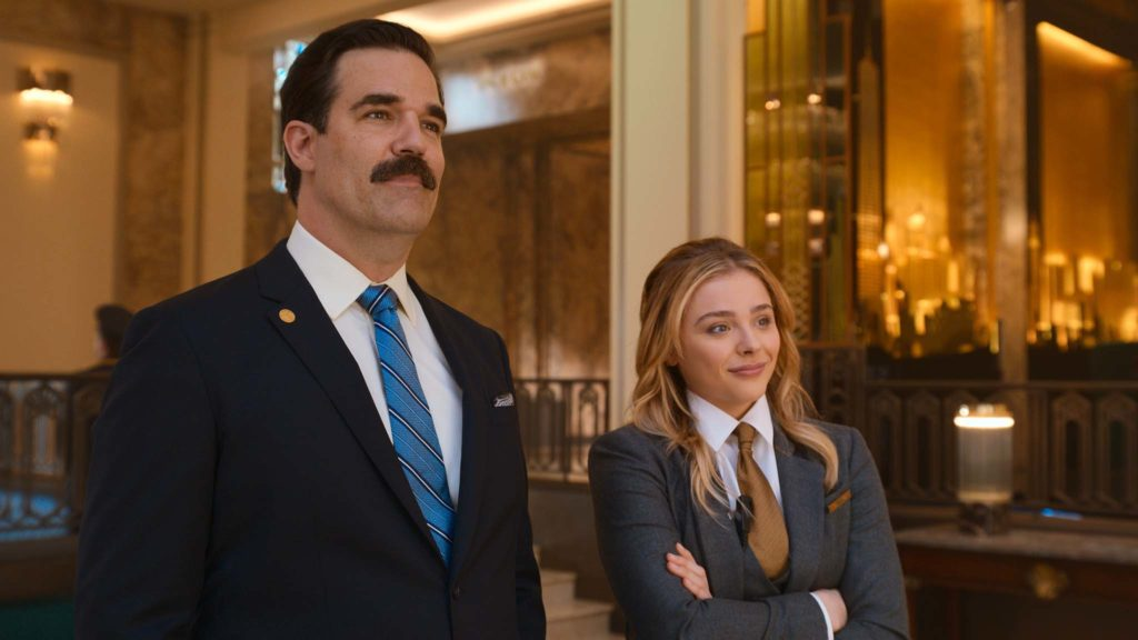 Rob Delaney as Mr Dubros and Chloe Grace Moretz as Kayla in Tom & Jerry The Movie, directed by Tim Story. Photo: courtesy Warner Bros. Pictures. Copyright: 2021 Warner Bros. Entertainment Inc. All Rights Reserved.