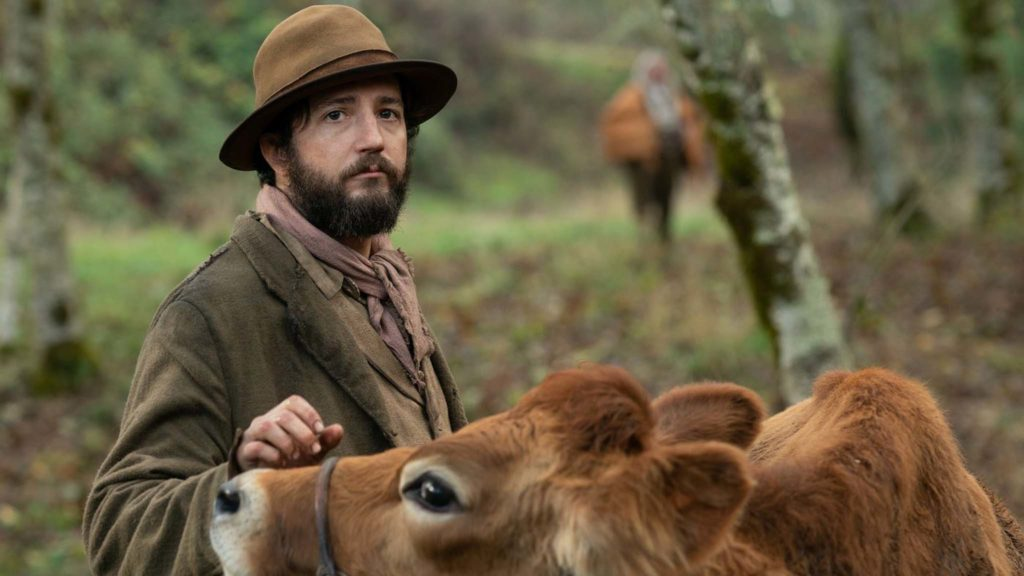 John Magaro as Cookie in First Cow, directed by Kelly Reichardt. Copyright: A24. All Rights Reserved.