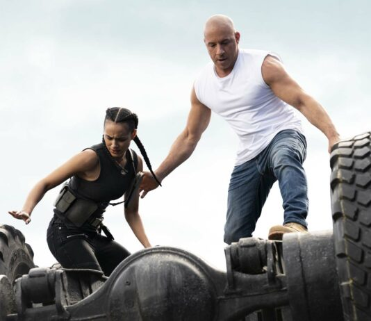 Nathalie Emmanuel as Ramsey and Vin Diesel as Dom in Fast & Furious 9, directed by Justin Lin. Photo: Giles Keyte. Copyright: 2020 Universal Studios. All Rights Reserved.