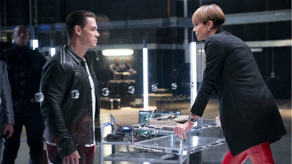 John Cena as Jakob and Charlize Theron as Cipher in Fast & Furious 9, directed by Justin Lin. Photo: Giles Keyte. Copyright: 2020 Universal Studios. All Rights Reserved.