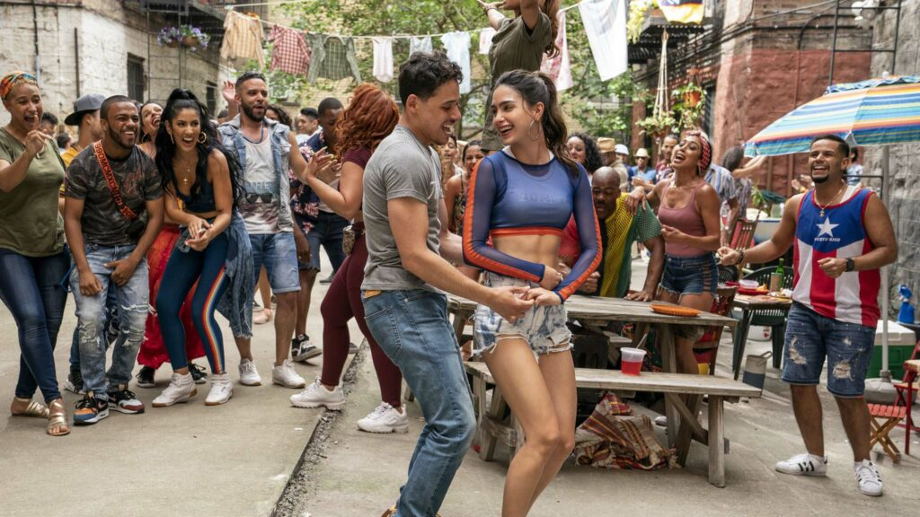 Anthony Ramos as Usnavi and Melissa Barrera as Vanessa in In The Heights, directed by Jon M Chu. Photo: Macall Polay. Copyright: 2019 Warner Bros. Entertainment Inc. All Rights Reserved.