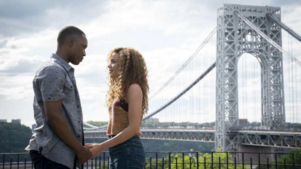 Corey Hawkins as Benny and Leslie Grace as Nina in In The Heights, directed by Jon M Chu. Photo: Macall Polay. Copyright: 2019 Warner Bros. Entertainment Inc. All Rights Reserved.