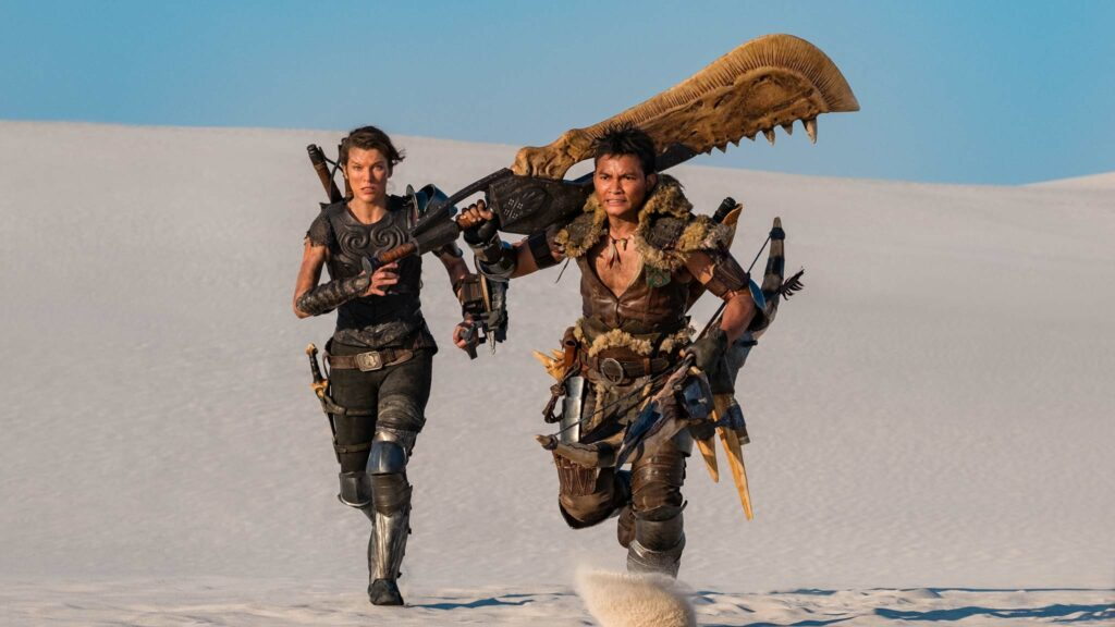 Milla Jovovich as Natalie Artemis and Tony Jaa as Hunter in Monster Hunter, directed by Paul WS Anderson. Photo: Coco Van Oppens. Copyright: Constantin Film VProduktion Services GmbH/Sony Pictures Releasing. All Rights Reserved.
