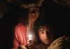 Thomasin McKenzie as Maddox and Alex Wolff as Trent in Old, directed by M Night Shyamalan. Photo: Phobymo. Copyright: 2021 Universal Studios. All Rights Reserved.
