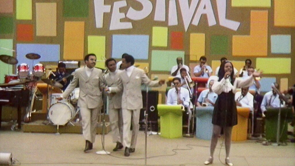 Gladys Knight & The Pips perform at the Harlem Cultural Festival in 1969, featured in the documentary Summer Of Soul, directed by Questlove. Copyright: 20th Century Studios. All Rights Reserved.