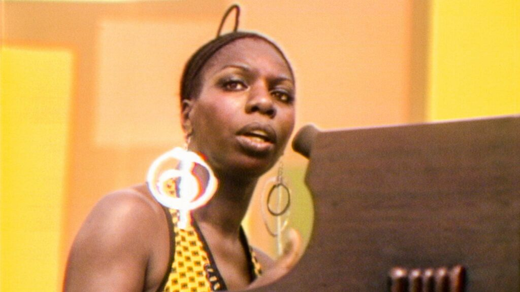 Nina Simone performs at the Harlem Cultural Festival in 1969, featured in the documentary Summer Of Soul, directed by Questlove. Copyright: 20th Century Studios. All Rights Reserved.