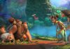Thunk (voiced by Clark Duke), Gran (Cloris Leachman), Sandy (Kailey Crawford), Ugga (Catherine Keener), Grug (Nicolas Cage) and Eep (Emma Stone) meet Phil (Peter Dinklage) and Hope Betterman (Leslie Mann) in The Croods 2: A New Age, directed by Joel Crawford. Copyright: DreamWorks Animation LLC. All Rights Reserved.