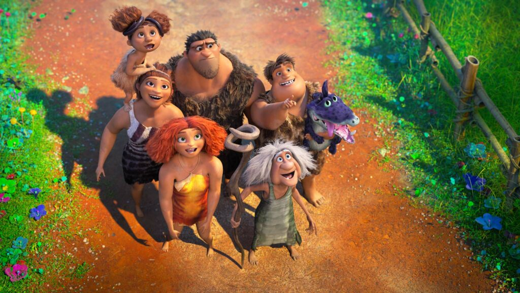 Sandy Crood (voiced by Kailey Crawford), Ugga Crood (Catherine Keener), Eep Crood (Emma Stone), Grug Crood (Nicolas Cage), Gran (Cloris Leachman) and Thunk Crood (Clark Duke) in The Croods 2: A New Age, directed by Joel Crawford. Copyright: DreamWorks Animation LLC. All Rights Reserved.