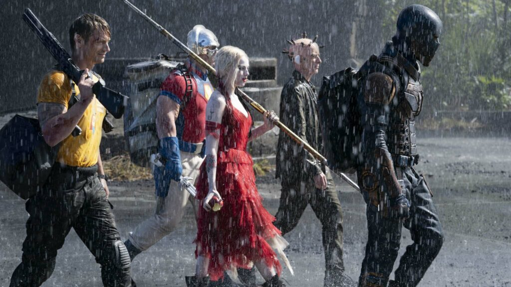Joel Kinnaman as Rick Flag, John Cena as Peacemaker, Margot Robbie as Harley Quinn, Peter Capaldi as The Thinker and Idris Elba as Bloodsport in The Suicide Squad, directed by James Gunn. Photo: Jessica Miglio. Copyright: 2019 Warner Bros. Entertainment Inc./DC Comics. All Rights Reserved.