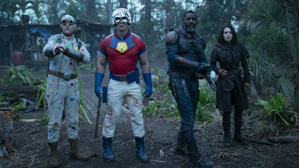 David Dastmalchian as Polka-Dot Man, John Cena as Peacemaker, Idris Elba as Bloodsport and Daniela Melchior as Ratcatcher 2 in The Suicide Squad, directed by James Gunn. Photo: Jessica Miglio. Copyright: 2019 Warner Bros. Entertainment Inc./DC Comics. All Rights Reserved.