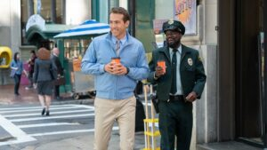 Ryan Reynolds as Guy and Lil Rel Howery as Buddy in Free Guy, directed by Shawn Levy. Photo: Alan Markfield. Copyright: 2020 Twentieth Century Fox Film Corporation. All Rights Reserved.