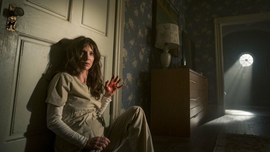 Annabelle Wallis as Madison in Malignant, directed by James Wan. Photo: Ron Batzdorff. Copyright: Warner Bros. Entertainment Inc. All Rights Reserved.
